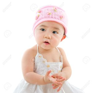 Portrait of cute Asian baby girl, isolated on white background